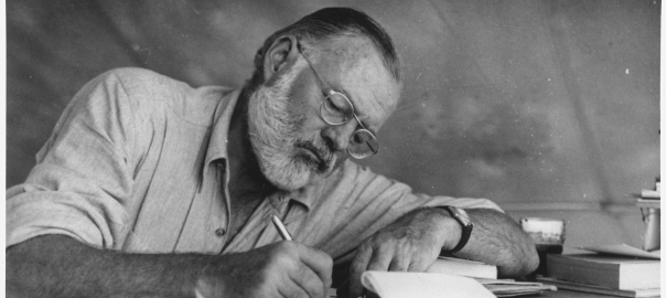 Ernest_Hemingway_Writing_at_Campsite_in_Kenya